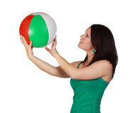 Woman holding a beach ball Stock Images