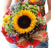 Woman holding beautiful birthday flower with sunflower Royalty Free Stock Image