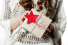 Woman holding beautifuly wrapped present, xmas concept Royalty Free Stock Images