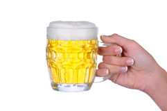 Woman holding beer mug Royalty Free Stock Images