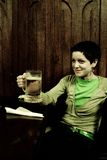 Woman holding beer mug Royalty Free Stock Image