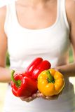 Woman holding bell peppers Royalty Free Stock Photos