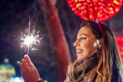 Woman holding bengal lights over bokeh background. Christmas con Stock Images