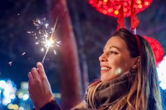Woman holding bengal lights over bokeh background. Christmas con Stock Photo