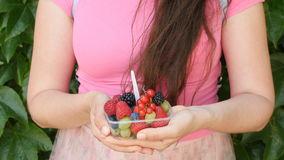 Woman holding berries and fruit in hands stock video