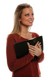 Woman holding bible. Woman in 20s holding bible looking up royalty free stock photo