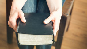 Woman Holding a Bible - Closeup Royalty Free Stock Image