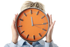 Woman holding big alarm clock Stock Photo