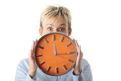 Woman holding big alarm clock Royalty Free Stock Photos