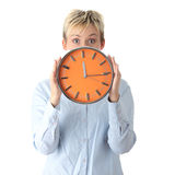 Woman holding big alarm clock Stock Images