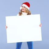 Woman holding a big blank sign Stock Photos