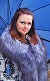 woman holding a big blue umbrella. Stock Photography