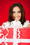Woman holding big Christmas present Royalty Free Stock Image