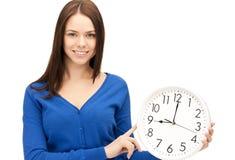 Woman holding big clock Stock Photos