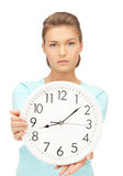 Woman holding big clock Stock Photos