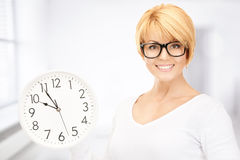 Woman holding big clock Stock Image
