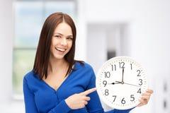 Woman holding big clock Stock Photo