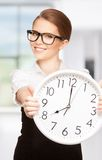Woman holding big clock Royalty Free Stock Image