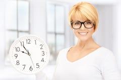 Woman holding big clock Royalty Free Stock Photos