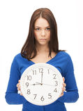 Woman holding big clock Royalty Free Stock Photos