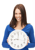 Woman holding big clock Royalty Free Stock Photography