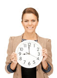 Woman holding big clock Stock Photography