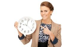 Woman holding big clock Royalty Free Stock Photography