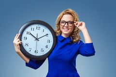 Woman holding big clock Stock Photo