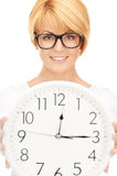 Woman holding big clock Royalty Free Stock Images