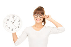 Woman holding big clock Stock Images