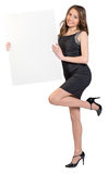 Woman is holding a big empty billboard, standing. On one leg royalty free stock photography