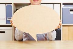 Woman holding big empty speech bubble Stock Photos
