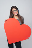 Woman holding big heart shape Royalty Free Stock Photo