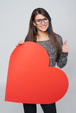 Woman holding big heart shape Royalty Free Stock Photography