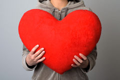 Woman holding a big heart Royalty Free Stock Photos