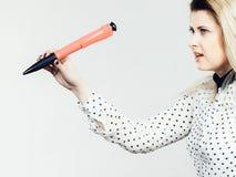 Woman holding big oversized pen Stock Photography