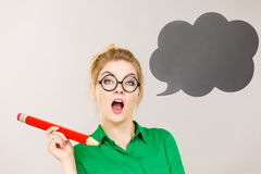 Woman holding big oversized pencil thinking Stock Images