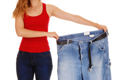 Woman holding big pants. Stock Images