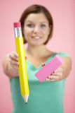 Woman Holding Big Pencil And Eraser royalty free stock photography