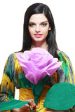 Woman holding big pink flower stock image