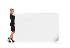 Woman holding big poster Stock Photos