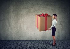 Woman holding a big present gift box royalty free stock photo