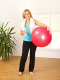 Woman holding big red ball Stock Photos