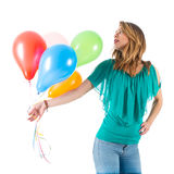 Woman holding big red balloon above her head royalty free stock image