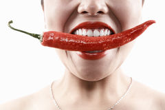 Woman holding big red chili in mouth. Woman holding big red chili in her mouth mouth Stock Image