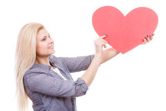 Woman holding big red heart, love sign Stock Photography