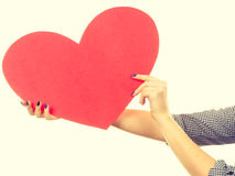 Woman holding big red heart, love sign Stock Images