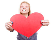 Woman holding big red heart, love sign Royalty Free Stock Photography