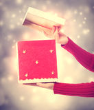 Woman holding a big red present box Royalty Free Stock Images