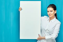 Woman holding big white banner with copy space stock photography